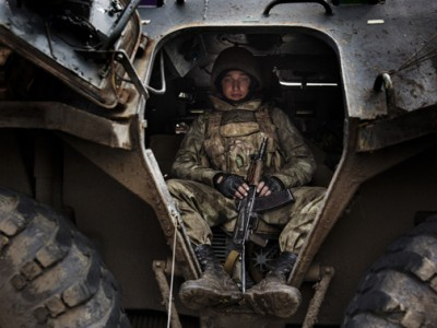 Ukrainian Soldier inside his tank.
