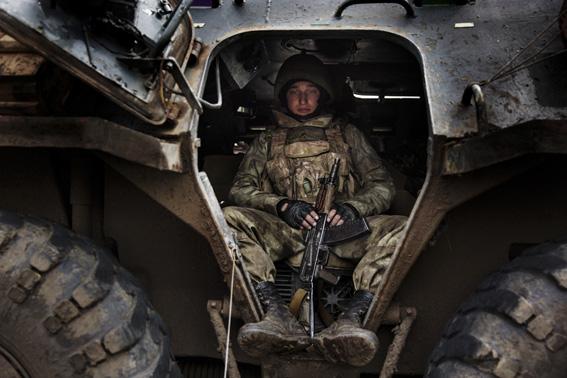 Ukrainian Soldier inside his tank.
