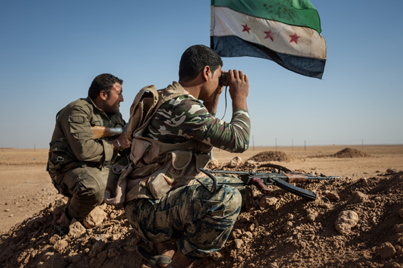 RAQQA COUNTRYSIDE, OCTOBER 17: Members of the Syrian armed group Liwa Thuwar al-Raqqa hold positions in the frontline against the Islamic State group outside Ayn al-Issa, in the countryside of Raqqa province.