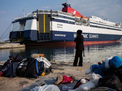 A Syrian family waiting to be embarked on a ferry - which will bring them to the peninsula-  at Mytilene's port on March 20, 2016.
